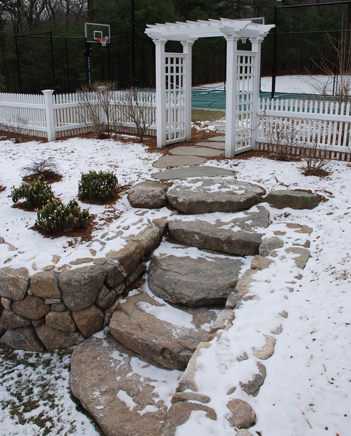 Natural Stone Steps with Retaining Wall and Pergola