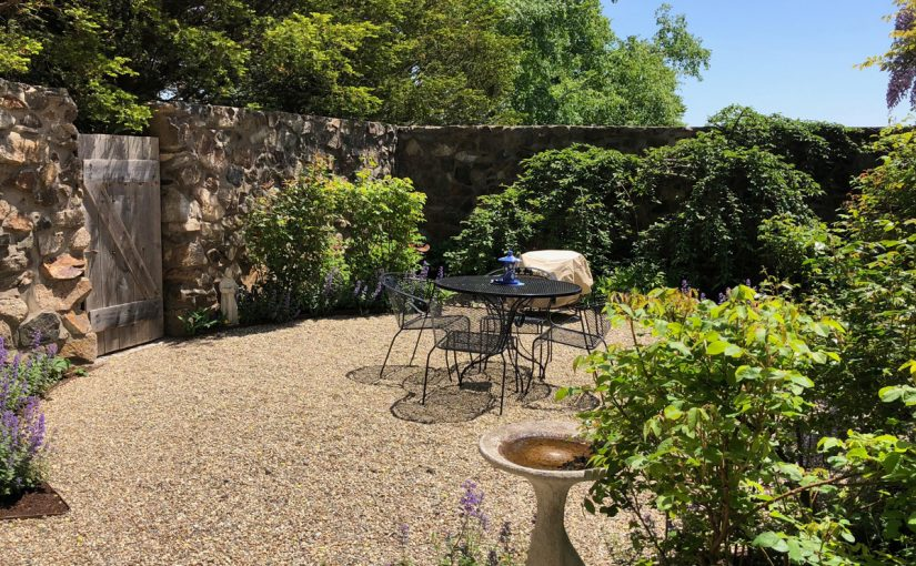 Private Garden with Stone Wall and Plants
