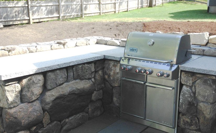 Slate Patio with Stone Wall and Built-in Grill