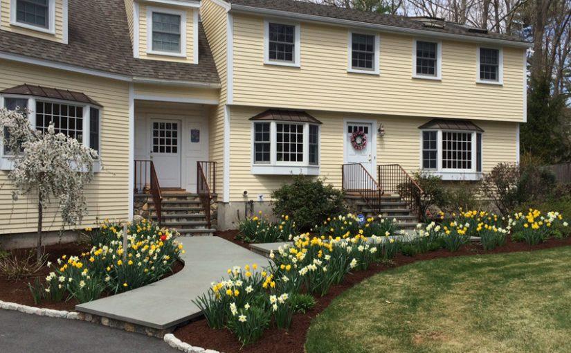 Walkway. flower bedding, and lawn installation